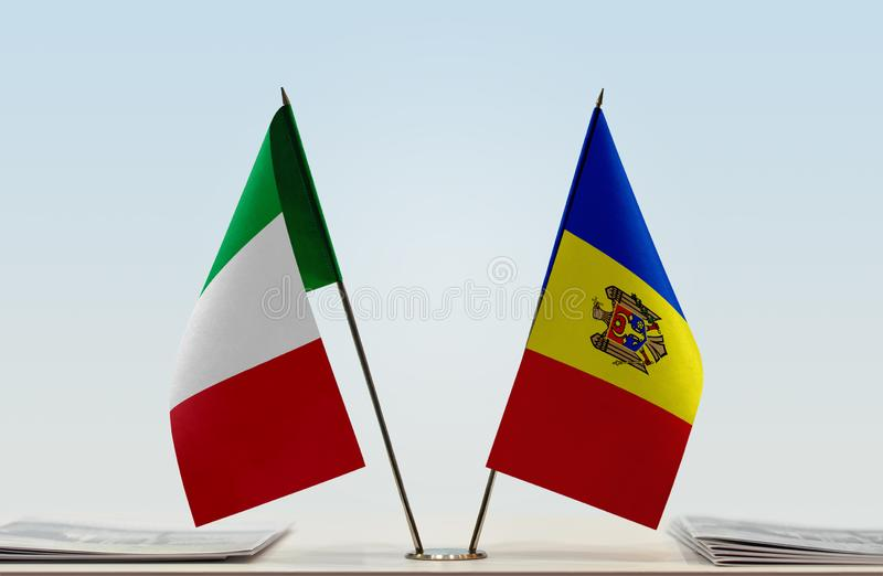 Flags of Italy and Moldova. Two table flags of Italy and Moldova stock images