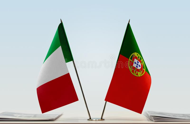 Flags of Italy and Portugal. Two table flags of Italy and Portugal royalty free stock photo
