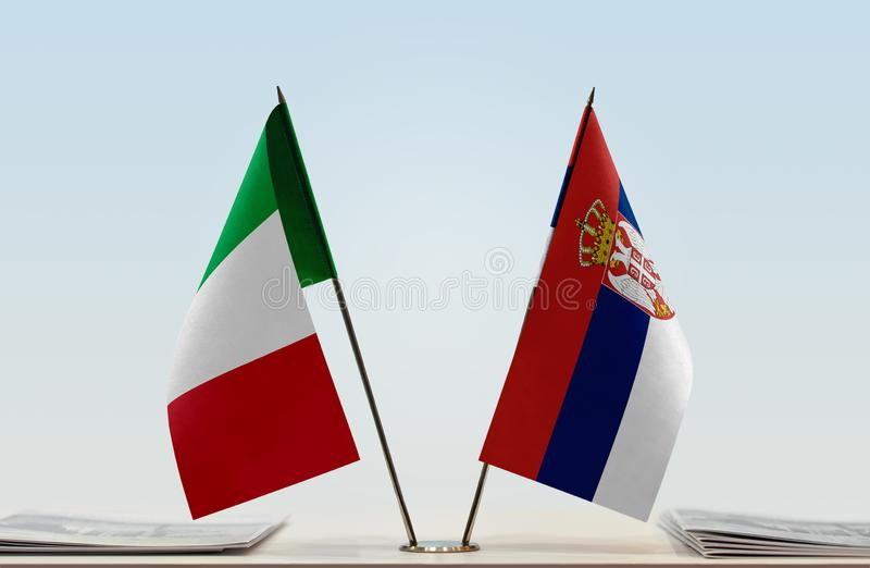 Flags of Italy and Serbia stock image