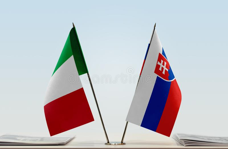 Flags of Italy and Slovakia. Two table flags of Italy and Slovakia stock photography