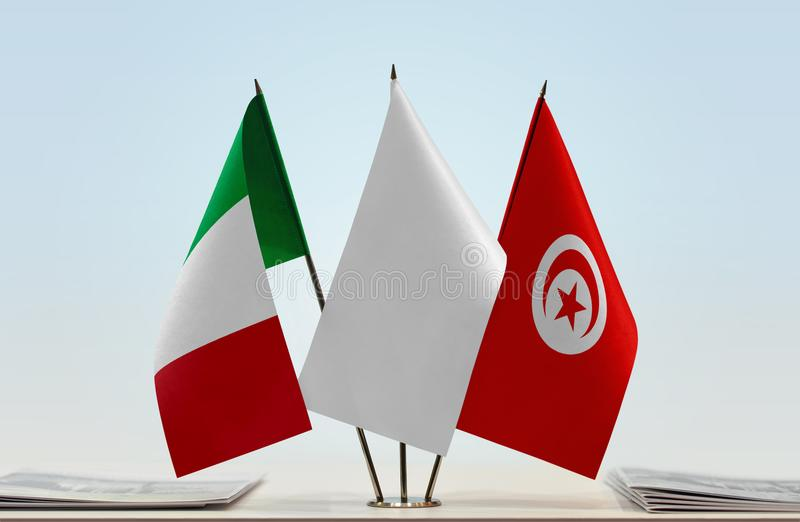 Flags of Italy and Tunisia. Desktop flags of Italy and Tunisia with white flag in the middle royalty free illustration