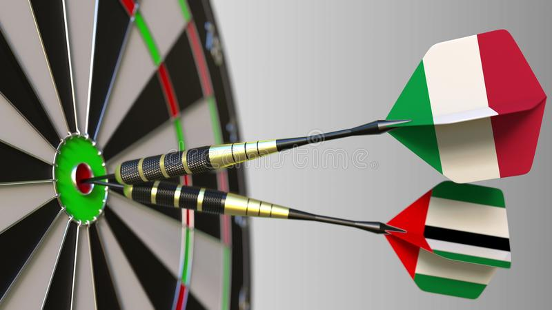 Flags of Italy and the UAE on darts hitting bullseye of the target. International cooperation or competition conceptual. Flags of Italy and the UAE on darts royalty free stock photography