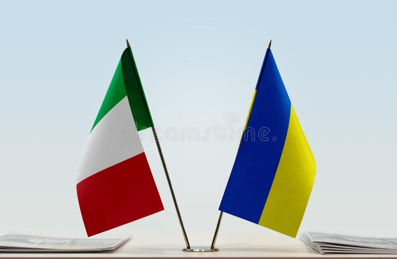 Flags of Italy and Ukraine. Two table flags of Italy and Ukraine royalty free stock images