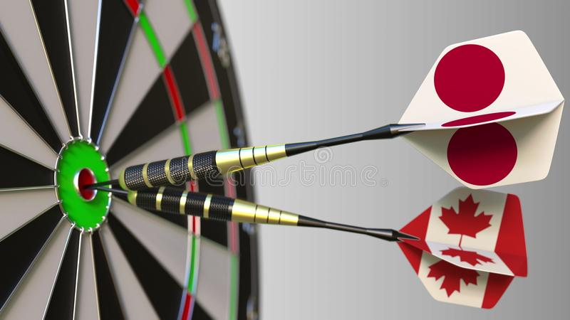 Flags of Japan and Canada on darts hitting bullseye of the target. International cooperation or competition conceptual. Flags of Japan and Canada on darts royalty free stock photography