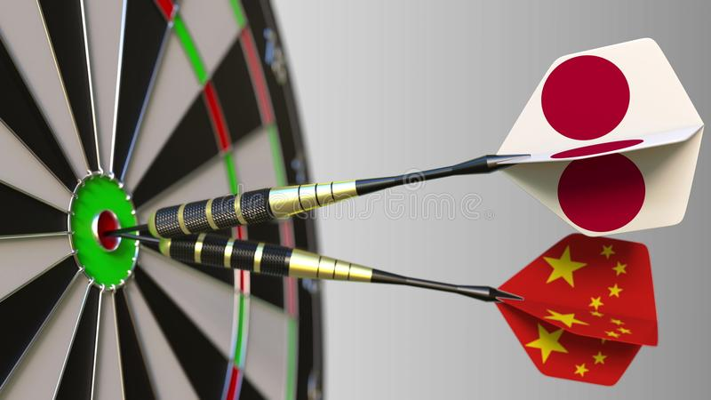 Flags of Japan and China on darts hitting bullseye of the target. International cooperation or competition conceptual 3D. Flags of Japan and China on darts stock photography