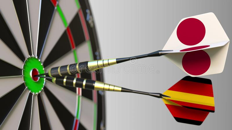 Flags of Japan and Germany on darts hitting bullseye of the target. International cooperation or competition conceptual. Flags of Japan and Germany on darts stock images