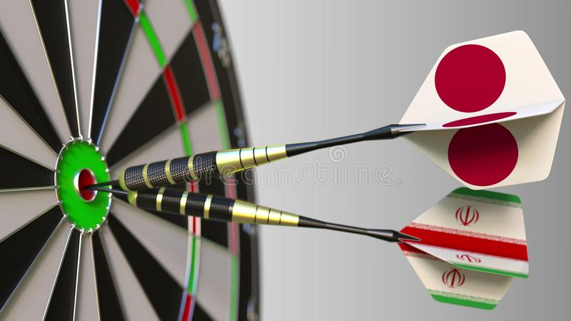 Flags of Japan and Iran on darts hitting bullseye of the target. International cooperation or competition conceptual 3D. Flags of Japan and Iran on darts hitting stock photos