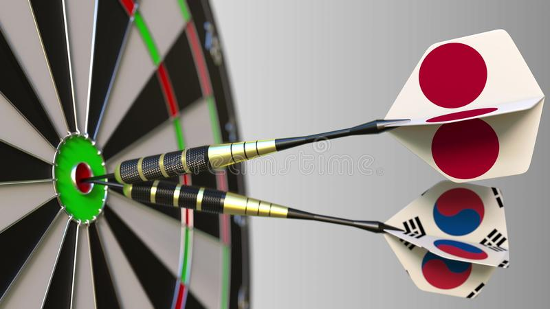 Flags of Japan and Korea on darts hitting bullseye of the target. International cooperation or competition conceptual 3D. Flags of Japan and Korea on darts stock image