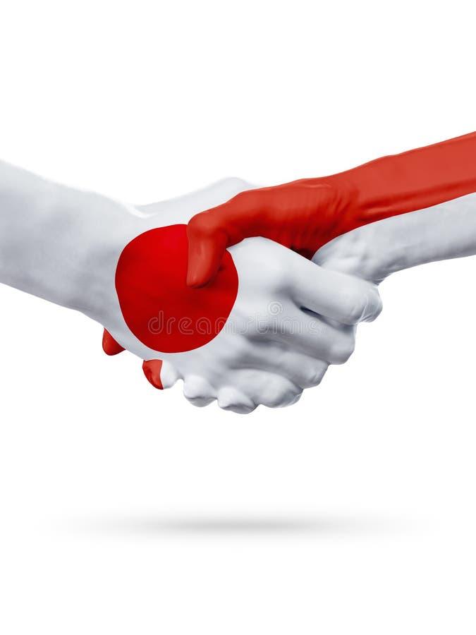 Flags Japan, Monaco countries, partnership friendship handshake concept. stock images