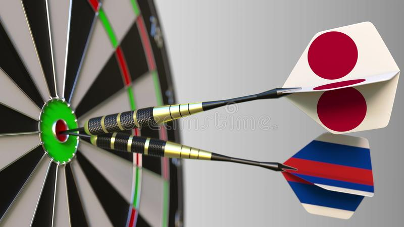 Flags of Japan and Russia on darts hitting bullseye of the target. International cooperation or competition conceptual. Flags of Japan and Russia on darts stock images