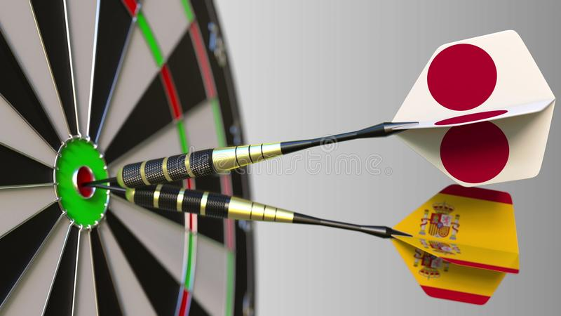 Flags of Japan and Spain on darts hitting bullseye of the target. International cooperation or competition conceptual 3D. Flags of Japan and Spain on darts stock image