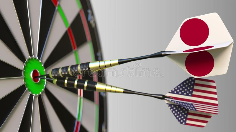 Flags of Japan and the USA on darts hitting bullseye of the target. International cooperation or competition conceptual. Flags of Japan and the USA on darts royalty free stock image