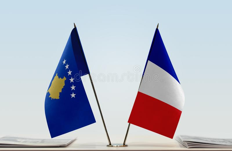 Flags of Kosovo and France. Two table flags of Kosovo and France royalty free stock image