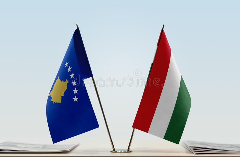 Flags of Kosovo and Hungary. Two table flags of Kosovo and Hungary stock photo