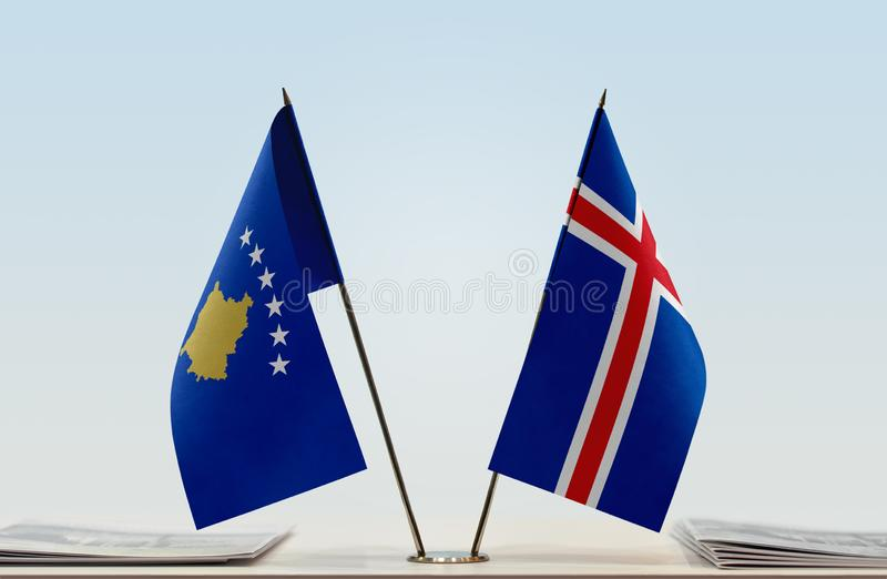 Flags of Kosovo and Iceland. Two table flags of Kosovo and Iceland royalty free stock photo
