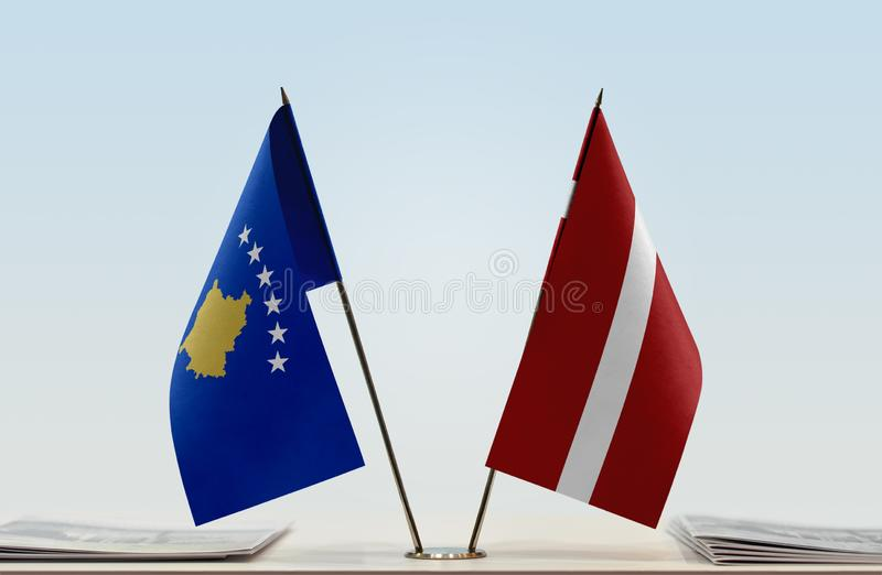 Flags of Kosovo and Latvia. Two table flags of Kosovo and Latvia royalty free stock photos