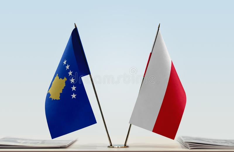 Flags of Kosovo and Poland. Two table flags of Kosovo and Poland royalty free stock photography