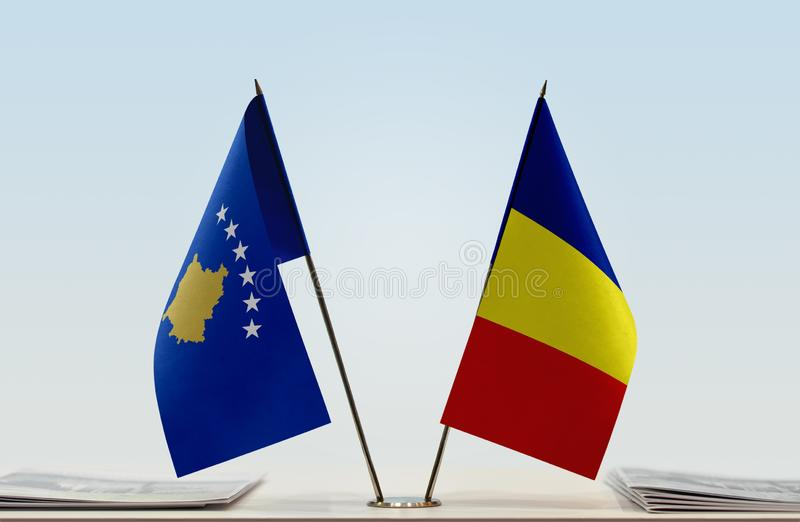 Flags of Kosovo and Romania. Two table flags of Kosovo and Romania stock images