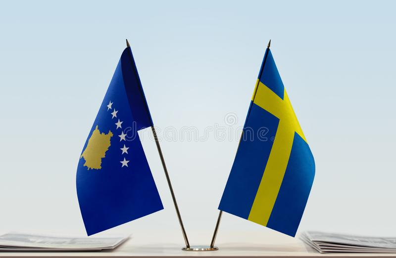 Flags of Kosovo and Sweden. Two table flags of Kosovo and Sweden royalty free stock photography