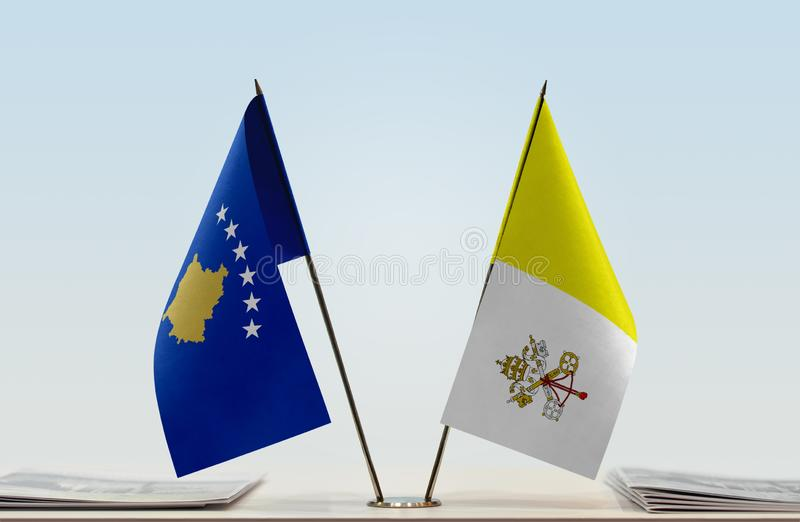 Flags of Kosovo and Vatican. Two table flags of Kosovo and Vatican stock photography