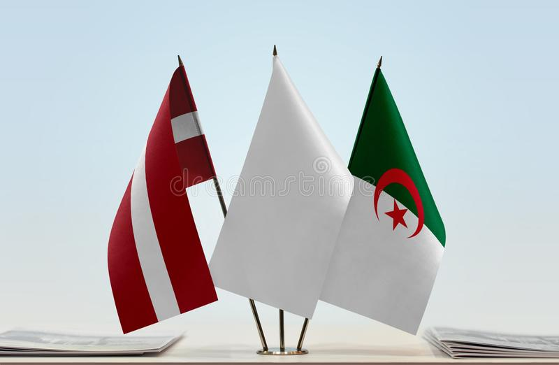 Flags of Latvia and Algeria. Desktop flags of Latvia and Algeria with white flag in the middle vector illustration