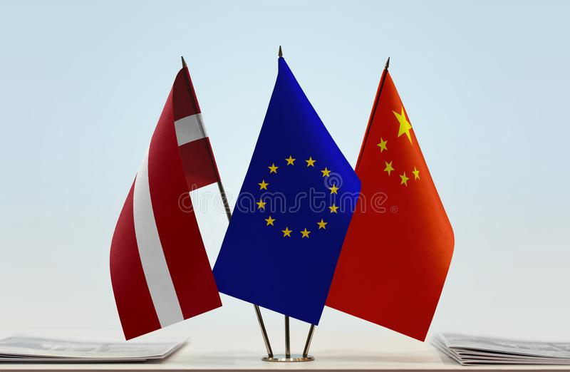 Flags of Latvia EU and China. Desktop flags of Latvia and China with European Union flag in the middle royalty free stock images