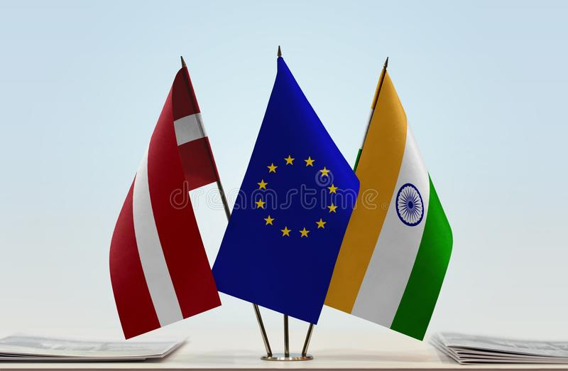 Flags of Latvia EU and India. Desktop flags of Latvia and India with European Union flag in the middle royalty free stock photos