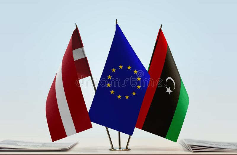 Flags of Latvia EU and Libya. Desktop flags of Latvia and Libya with European Union flag in the middle stock images