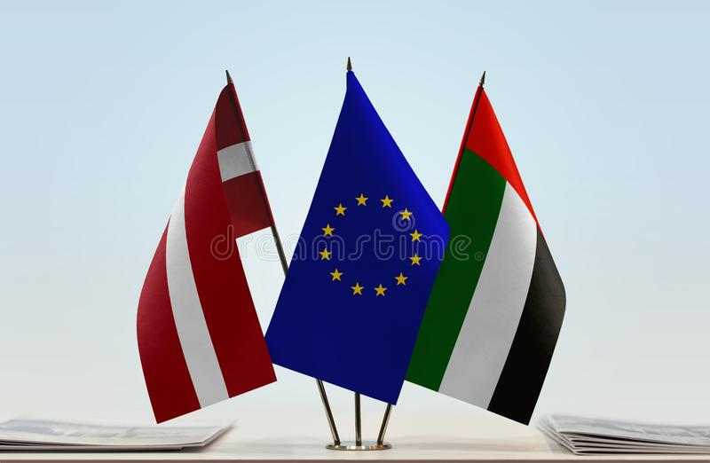 Flags of Latvia EU and UAE. Desktop flags of Latvia and UAE with European Union flag in the middle stock photos