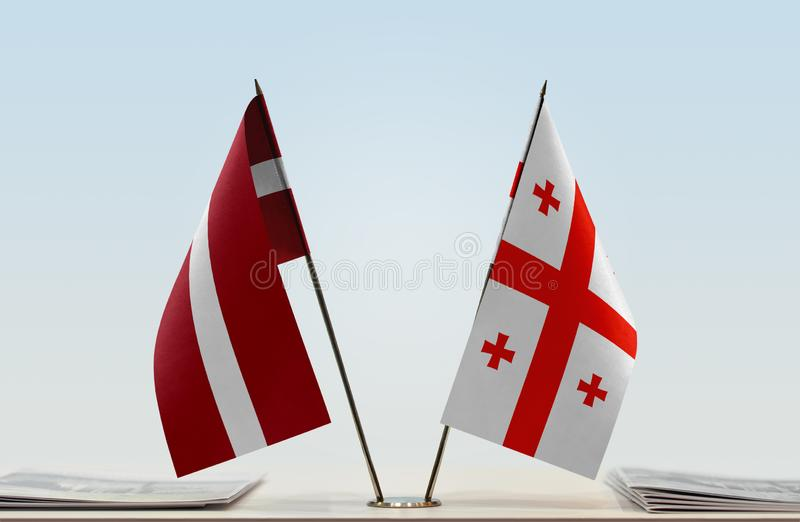 Flags of Latvia and Georgia. Two table flags of Latvia and Georgia stock images