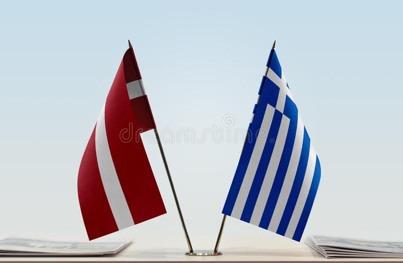 Flags of Latvia and Greece. Two table flags of Latvia and Greece stock photography