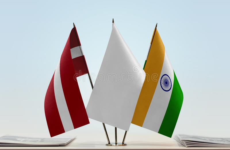 Flags of Latvia and India. Desktop flags of Latvia and India with white flag in the middle royalty free stock images