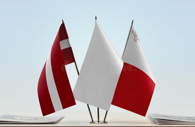 Flags of Latvia and Malta. Desktop flags of thuania and Malta with a white flag in the middle stock images