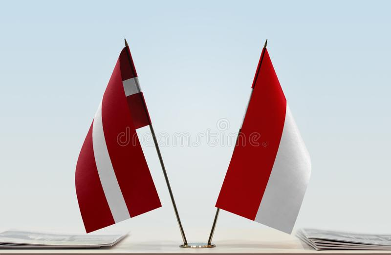 Flags of Latvia and Monaco. Two table flags of Latvia and Monaco stock photos