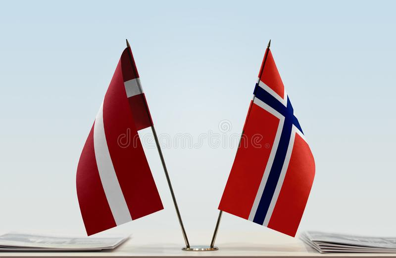 Flags of Latvia and Norway. Two table flags of Latvia and Norway stock image