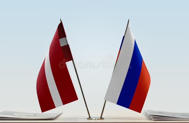 Flags of Latvia and Russia. Two table flags of Latvia and Russia stock images