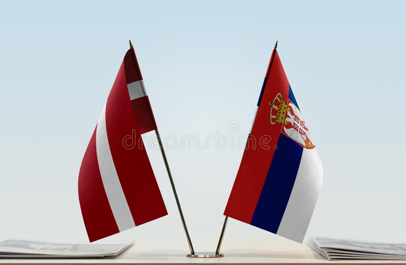 Flags of Latvia and Serbia. Two table flags of Latvia and Serbia stock photos