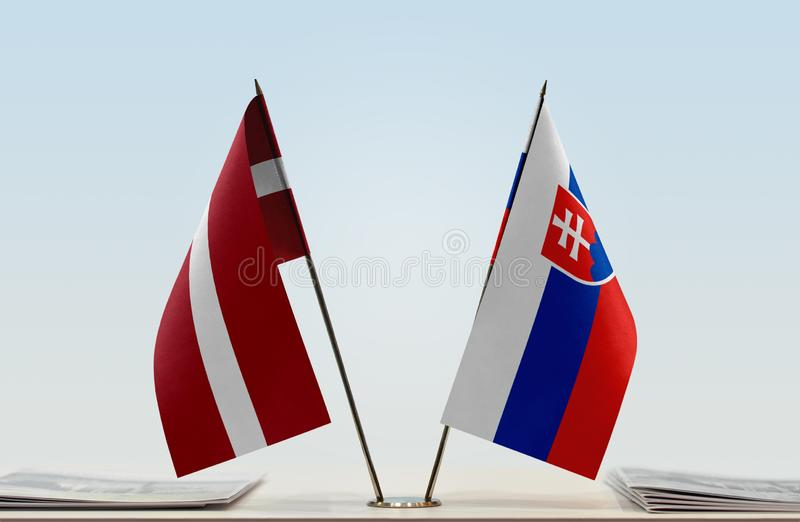 Flags of Latvia and Serbia. Two table flags of Latvia and Serbia royalty free stock photo