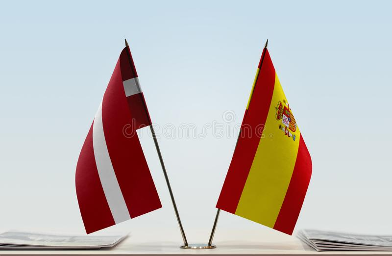 Flags of Latvia and Spain stock photos