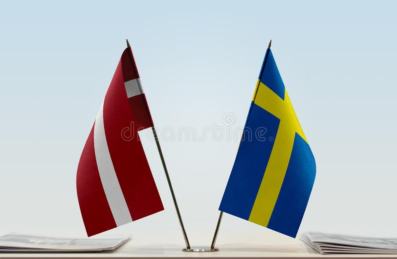 Flags of Latvia and Sweden. Two table flags of Latvia and Sweden stock images