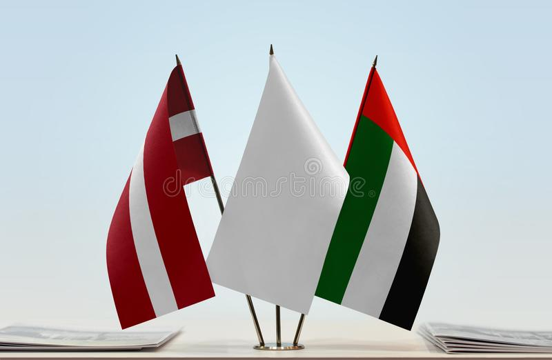 Flags of Latvia and UAE royalty free stock photography