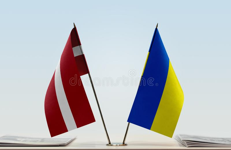 Flags of Latvia and Ukraine. Two table flags of Latvia and Ukraine stock photo