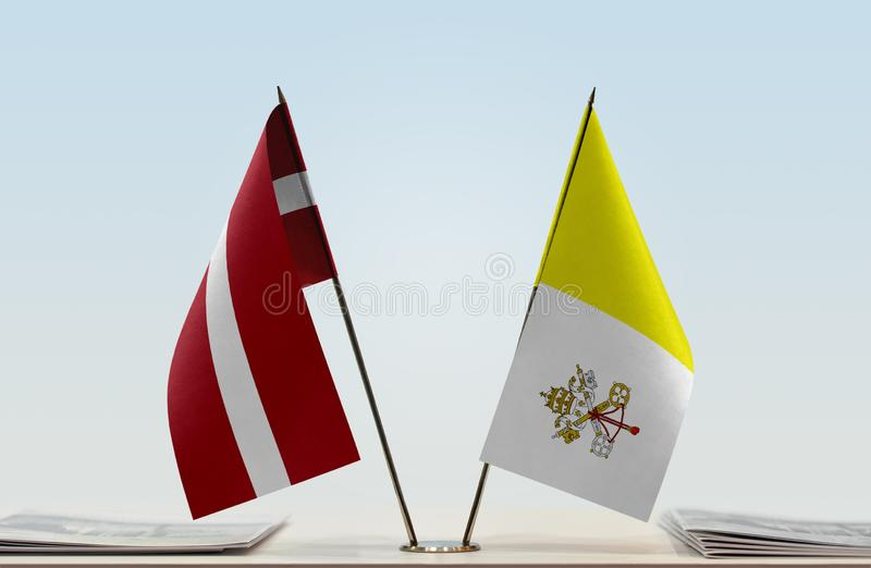 Flags of Latvia and Vatican. Two table flags of Latvia and Vatican stock photography
