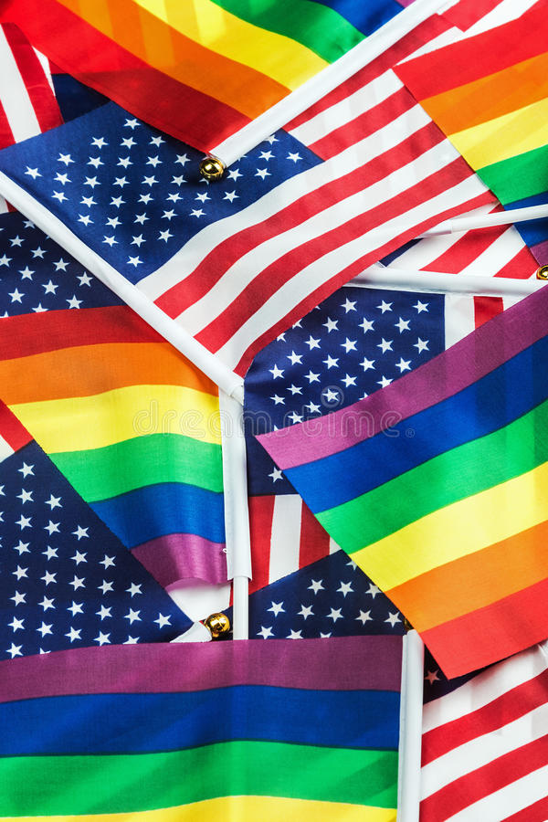 Flags of the LGBT community on a background of the American flag stock photography