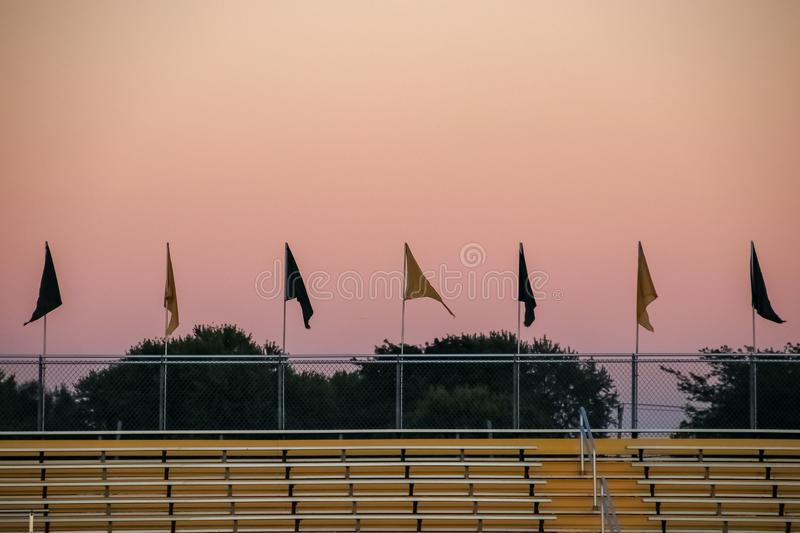 Flags line bleachers of sports game stock photography