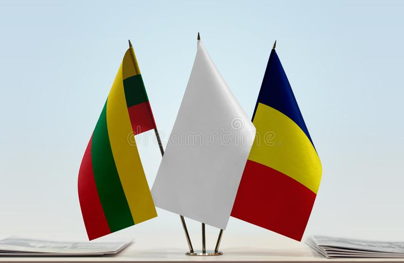 Flags of Lithuania and Chad. Desktop flags of Lithuania and Chad with white flag in the middle royalty free stock images