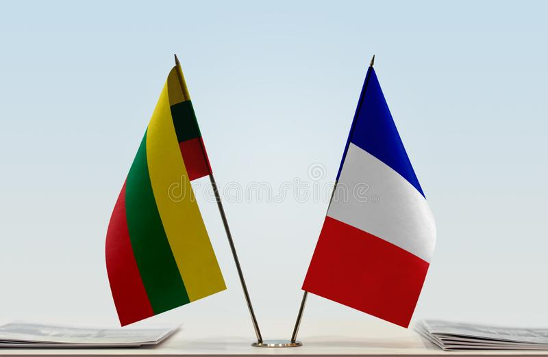 Flags of Lithuania and France. Two table flags of Lithuania and France royalty free stock photo