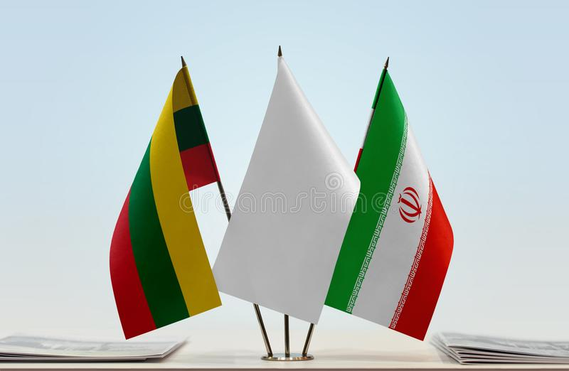 Flags of Lithuania and Iran. Desktop flags of Lithuania and Iran with white flag in the middle royalty free stock photography