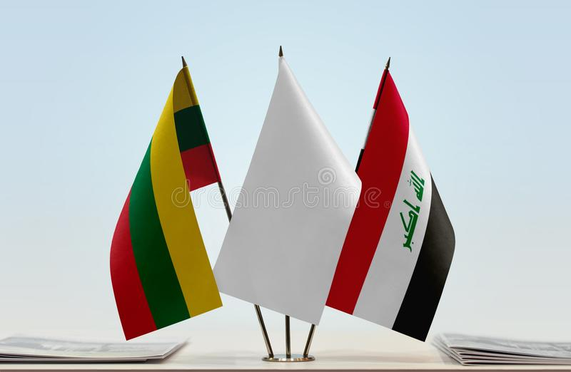 Flags of Lithuania and Iraq. Desktop flags of Lithuania and Iraq with white flag in the middle royalty free stock photography