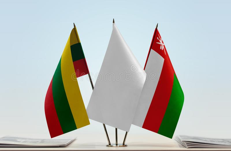 Flags of Lithuania and Oman. Desktop flags of Lithuania and Oman with white flag in the middle royalty free stock photography